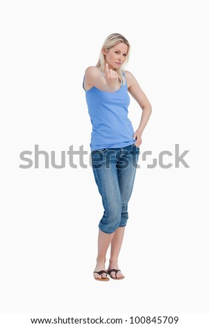 Serious woman telling to come on with her finger against a white background Stock photo © wavebreak_media