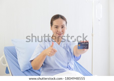 A blonde woman with her thumb held up is smiling at the camera Stock photo © wavebreak_media