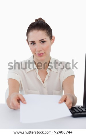 Portrait of a businesswoman giving a document against a white background stock photo © wavebreak_media