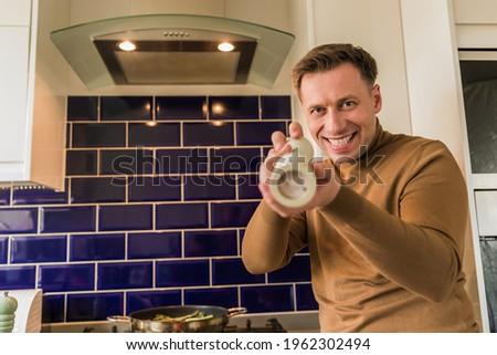 Confident chef holding salt shaker Stock photo © wavebreak_media