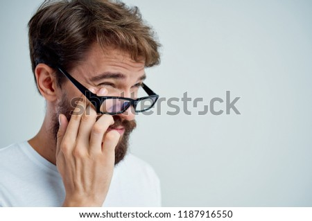 young businessman looking tired with glasses lowered and hand to his head Stock photo © photography33