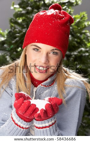 Fashionable Teenage Girl Wearing Cap And Knitwear Holding Snowba Stock photo © monkey_business
