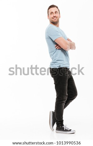 full length portrait of a happy man with arms folded over white background stock photo © deandrobot