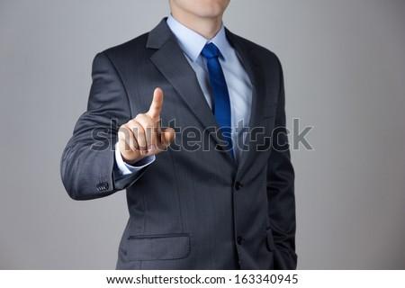 Mão homem de negócios empurrando botão tela sensível ao toque interface Foto stock © Suriyaphoto