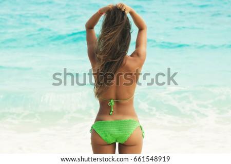 Suntanning bikini woman walking on tropical beach, back outdoor  Stock photo © Victoria_Andreas