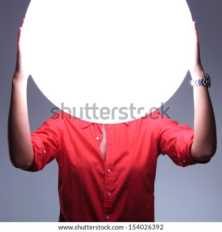 Woman holding her hands over glowing sphere of light. Protection, future. Stock photo © photocreo