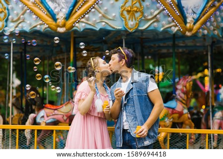 Romantic couple kissing with love in park. Soap bubbles flying Stock photo © photocreo