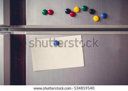 Fridge freezer door with magnets and note Stock photo © adrian_n