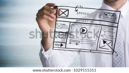 Stock photo: Business man with marker and website mock up against blurry grey wood panel