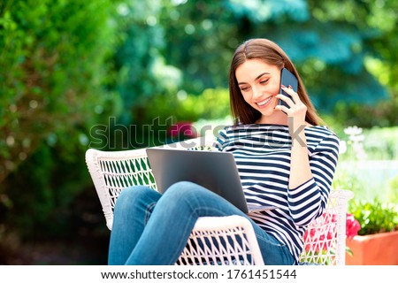 Woman using mobile phone while relaxing on lounge chair at beach Stock photo © wavebreak_media