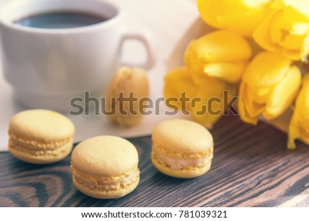 Beautiful spring music background. Cup of coffee, macaroons, yel Stock photo © artsvitlyna