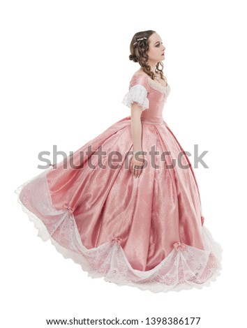 Young beautiful woman in long medieval dress isolated on white Stock photo © Lopolo