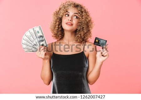 Photo of delighted curly woman 20s holding fan of dollar money w Stock photo © deandrobot