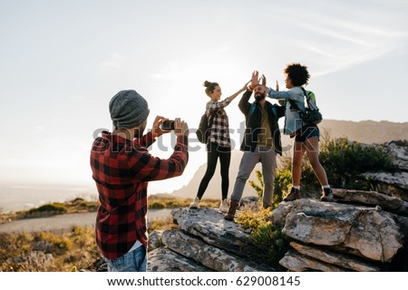 portrait of happy woman taking picture on smartphone while ridi stock photo © deandrobot