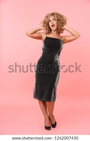 full length portrait of amazing curly woman 20s wearing dress sm stock photo © deandrobot