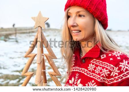 Woman holding a timber Christmas Tree, Christmas season, Christmas in July themes Stock photo © lovleah