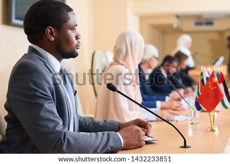 Young serious African-american delegate and participant of political forum Stock photo © pressmaster