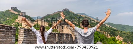 Happy cheerful joyful tourist man at Great Wall of China having fun on travel smiling laughing and d Stock photo © galitskaya