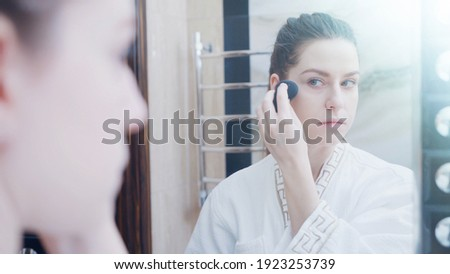 Bőrápolás hölgy arckrém vonzó barna hajú lány Stock fotó © serdechny