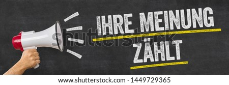 A man holding a megaphone - Your opinion matters - Ihre Meinung  Stock photo © Zerbor