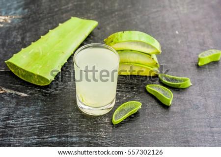 Aloe vera pieces and aloe gel in the glass on an old dark wood background Organic cosmetics concept Stock photo © galitskaya