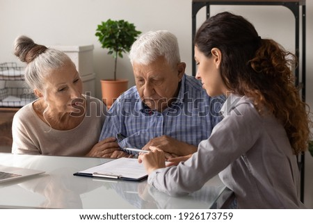 Mature couple listening to agent making presentation of financial program Stock photo © pressmaster