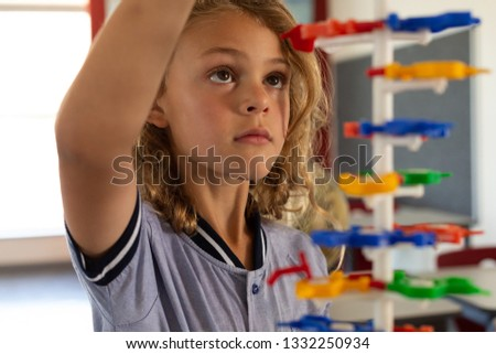 Close-up of mixed -race schoolgirl interacting with a DNA model in classroom at elementary school Stock photo © wavebreak_media