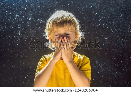 Allergy to dust. Boy sneezes because he is allergic to dust. Dust flies in the air backlit by light Stock photo © galitskaya