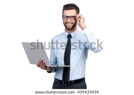 Happy young businessman with laptop surfing in the net with colleagues near by Stock photo © pressmaster