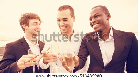 Cheerful young well-dressed man with flute of champagne relaxing in bathtub Stock photo © pressmaster