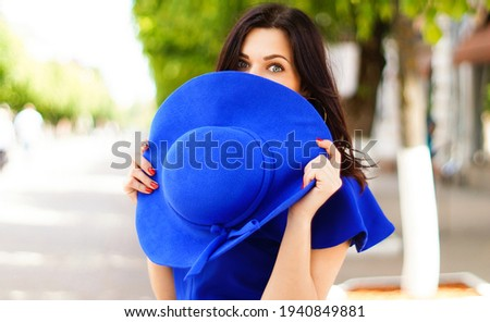 Portrait of a woman with green eyes with a hat on her head close up Stock photo © ElenaBatkova