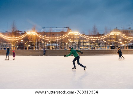 Happy active sporty male involved in winter activities, demonstr Stock photo © vkstudio
