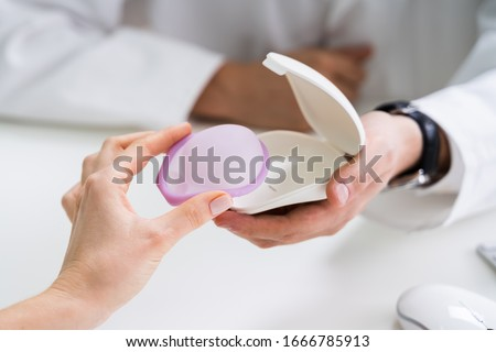 Gynecologist Consulting Woman On Diaphragm Contraception Method Stock photo © AndreyPopov