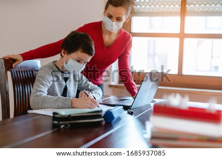 Stock photo: Mother and child having e-learning session with teacher during crisis