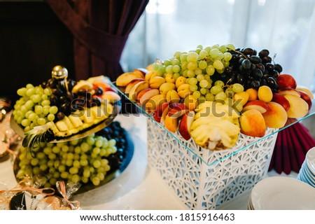 Healthy fruit platter. Selective focus. Bowl of cut colorful mango, figs, grape and papaya on dark b Stock photo © vkstudio