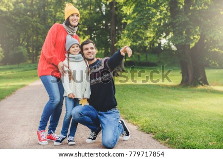 Pleasant looking dad shows with fore finger beautiful landscape  Stock photo © vkstudio