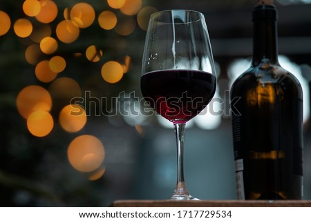 Glass of red wine, pouring drink at luxury holiday tasting event Stock photo © Anneleven