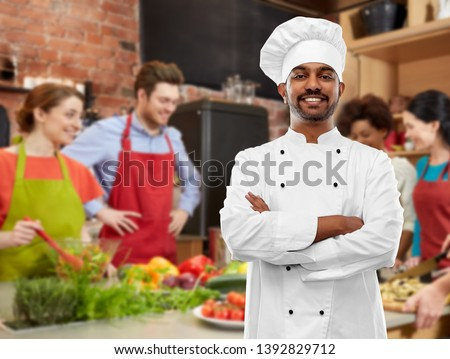 happy male indian chef in toque at cooking class Stock photo © dolgachov