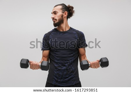 Image of attractive brunette sportsman wearing tracksuit lifting Stock photo © deandrobot