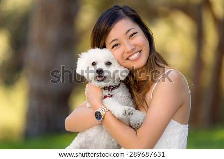 Beautiful happy family is having fun with maltese dog outdoors Stock photo © boggy