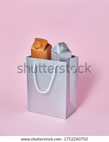 Mock-up silver paper bag with two milk packages on a pink background. Stock photo © artjazz