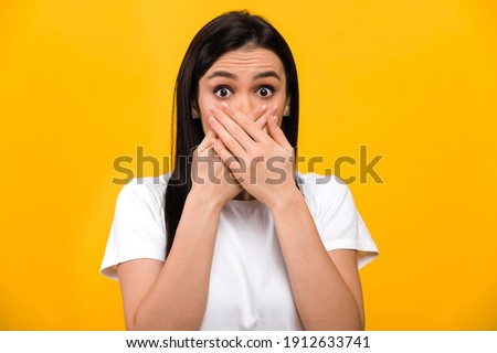 Photo of excited girl expressing surprise and covering her mouth Stock photo © deandrobot