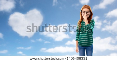 red haired student girl in glasses over blue sky Stock photo © dolgachov