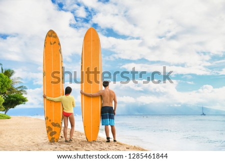 Beach couple surfing in Hawaii relaxing at sunset standing with surfboards on waikiki beach, Honolul Stock photo © Maridav