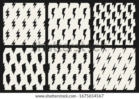 Set of vector monochrome simple seamless thunderbolt patterns. Trendy endless flash textile textures Stock photo © ExpressVectors