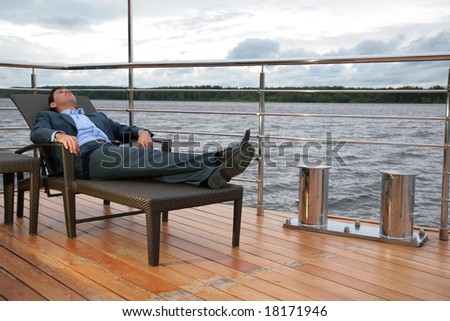Portrait of man, who rests in chaise lounge on  wharf near water Stock photo © Paha_L