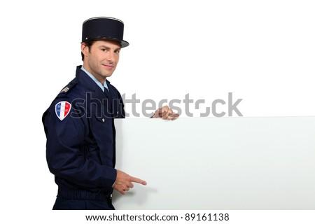 Człowiek francuski uniform wskazując pokładzie gotowy Zdjęcia stock © photography33