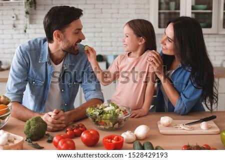 Man preparing salad in kitchen Stock photo © photography33