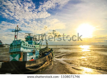 Red and White Sailing boat stranded at low tide in ocean Mozambi Stock photo © jacojvr