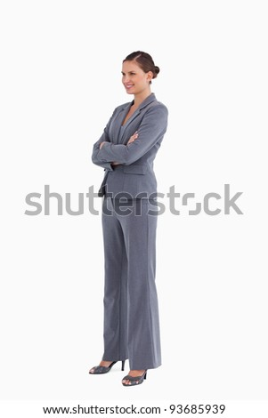 Side view of a woman smiling with arms crossed against a white background Stock photo © wavebreak_media